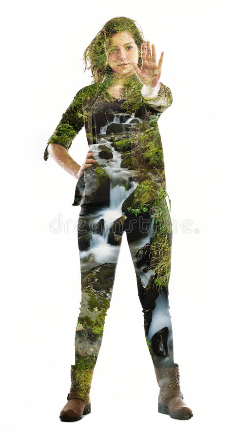 Double exposure of nature and young woman dancing royalty free stock photography