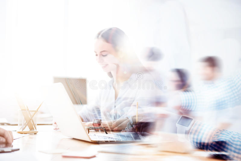 Double exposure of nice smiling girl working on laptop stock image