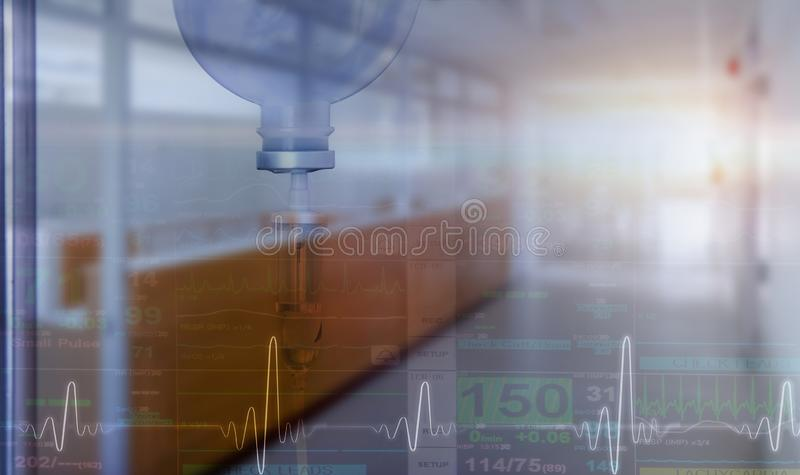 Double exposure normal saline and blurred hospital ward. With ecg and vital sign of mornitor screen stock photo