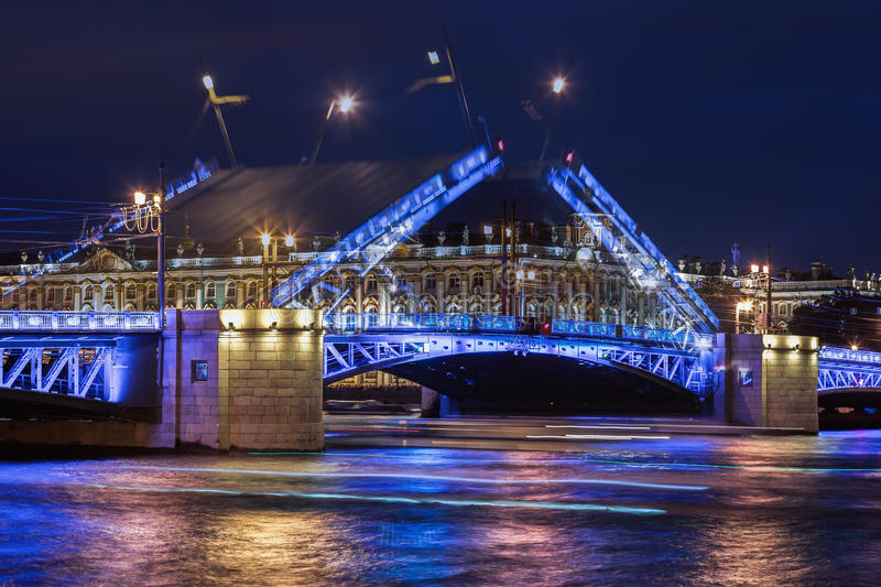 Double exposure, open Palace bridge, white nights in Saint-Petersburg. A view of the Hermitage royalty free stock image
