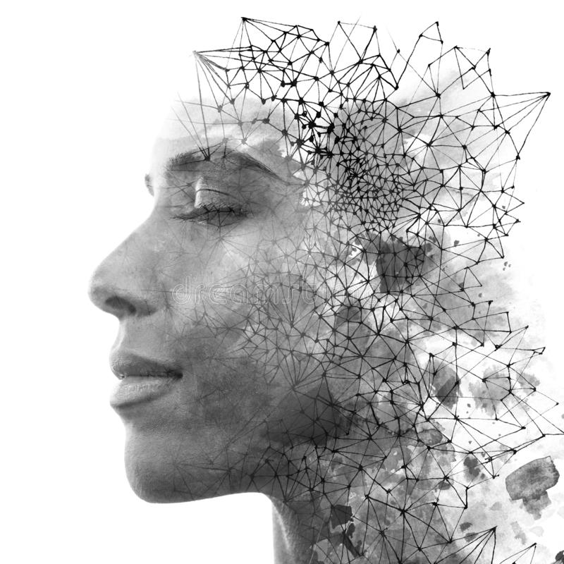 Double exposure. Paintography. Close up portrait of an attractive woman with strong ethnic features combined with unusual hand royalty free stock photo
