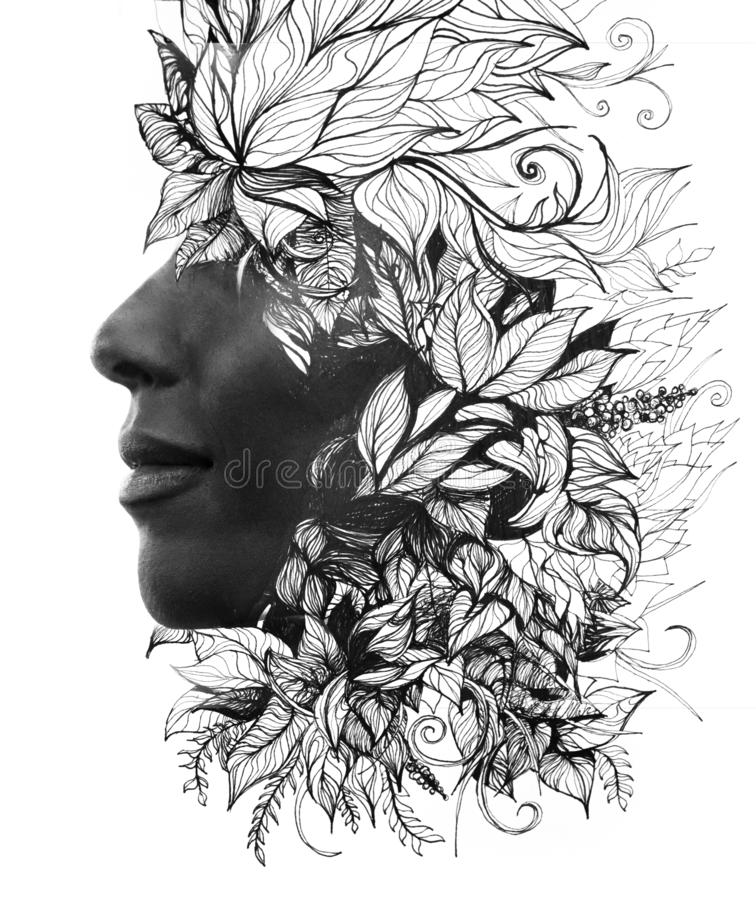 Double exposure. Paintography. Close up profile portrait of an attractive woman with strong ethnic features combined with unusual stock image