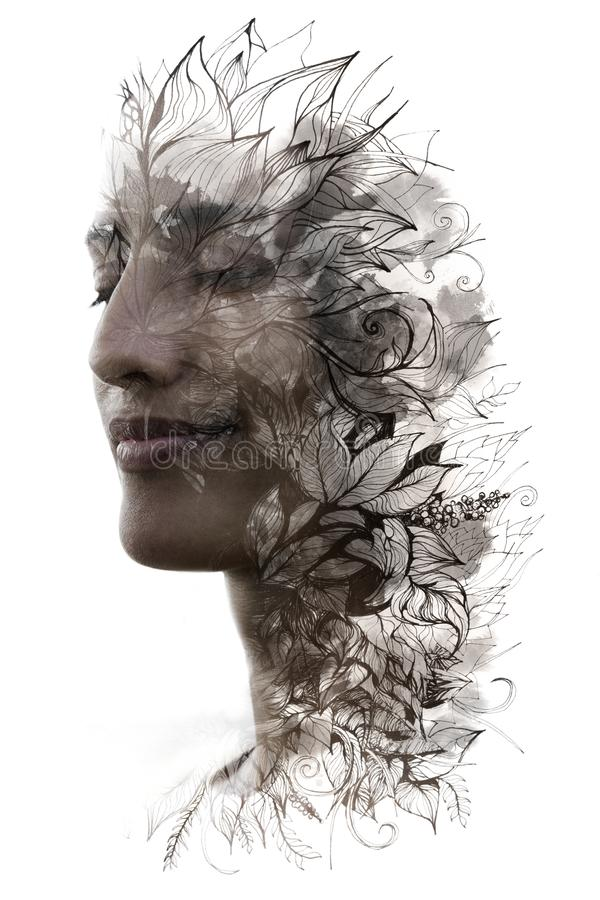 Double exposure. Paintography. Close up profile portrait of an attractive woman with strong ethnic features combined with unusual stock images