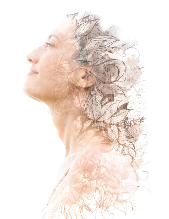 Double exposure. Paintography. Close up profile portrait of an attractive woman with strong ethnic features combined with unusual royalty free stock photo