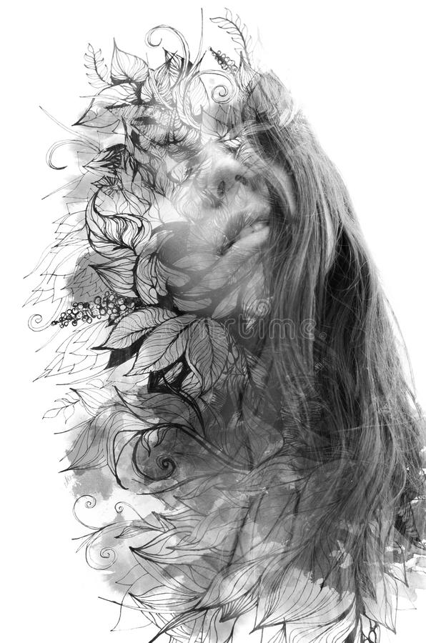 Double exposure. Paintography. Close up portrait of an attractive woman with strong ethnic features combined with unusual hand stock photography