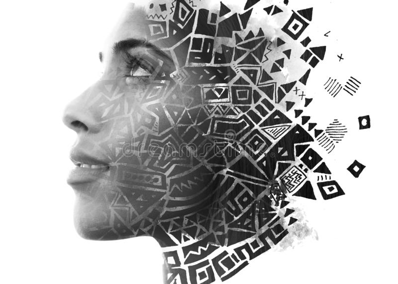 Double exposure. Paintography. Close up portrait of an attractive woman with strong ethnic features combined with unusual hand stock photo