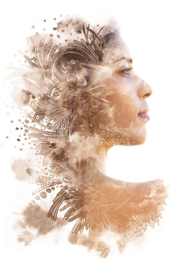 Double exposure. Paintography. Profile portrait of an attractive woman with strong features combined with unusual hand drawn royalty free illustration