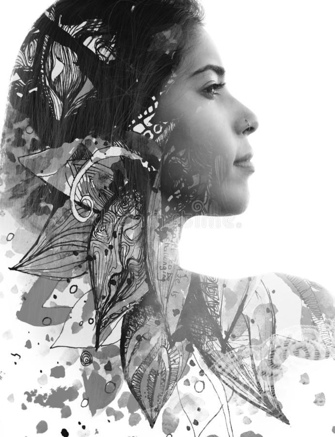 Double exposure. Paintography. Profile portrait of an attractive woman with strong ethnic features combined with unusual hand made royalty free stock photography