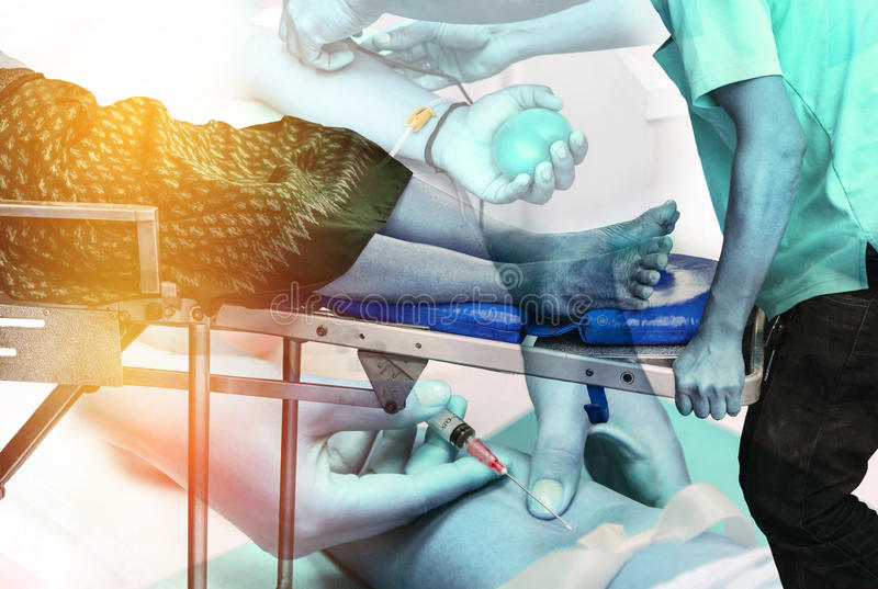 Double exposure paramedic stretcher to transport patient with nurse pricking needle syringe in the arm. Double exposure paramedic and rescue stretcher to royalty free stock photo