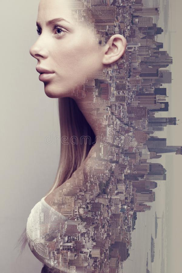 Double exposure portrait of beautiful blonde woman merged with urban city royalty free stock photos