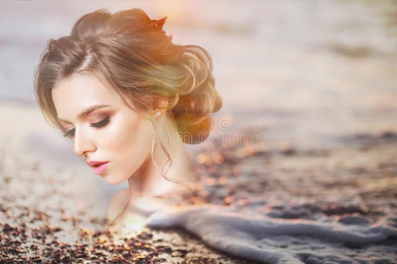 Double exposure portrait of a beautiful girl. By the sea in sunlight stock photos