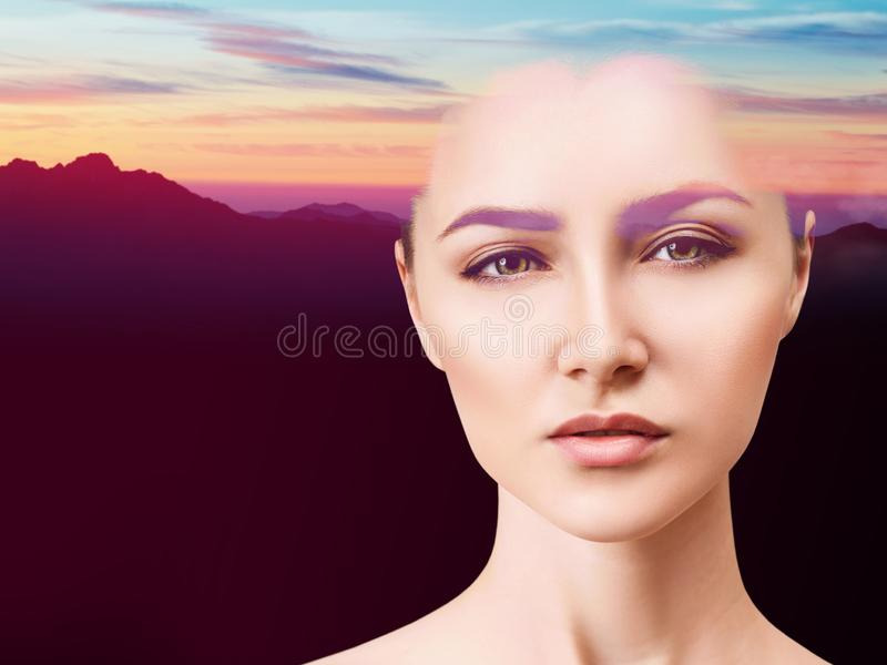 Double exposure of beautiful woman face and sunset. royalty free stock image