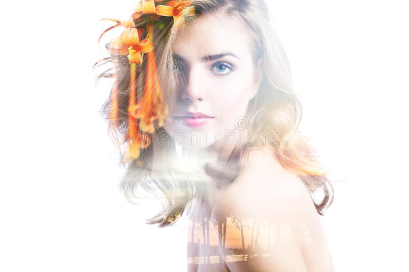 Double exposure portrait of beautiful woman, sunset sea and flowers. Concept of travel, vacation, human harmony and nature royalty free stock photos