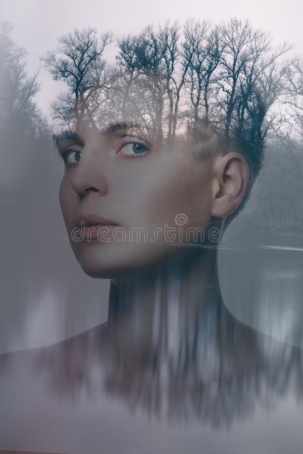 Double exposure portrait of a beautiful young woman royalty free stock images