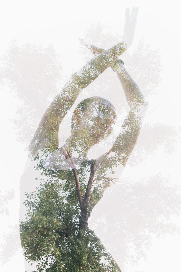 Double exposure portrait of dancing woman combined with tree photography stock images