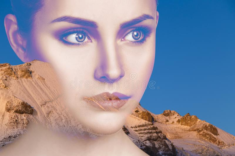 Double exposure portrait of young beautiful woman and mountains. royalty free stock images