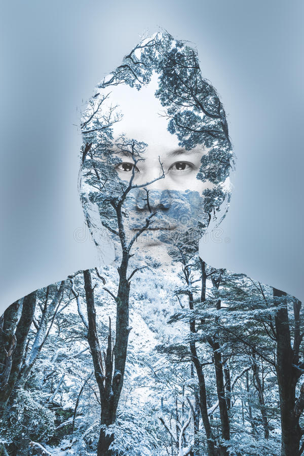 Double exposure portrait of young woman and winter forest stock photos