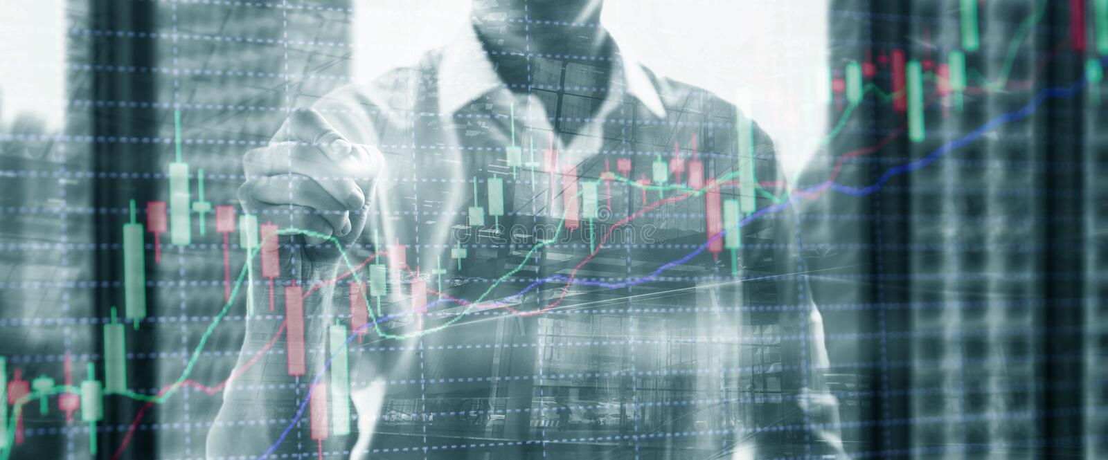 Double exposure of professional trader. Stock candles graph of stocks market.  royalty free stock photo