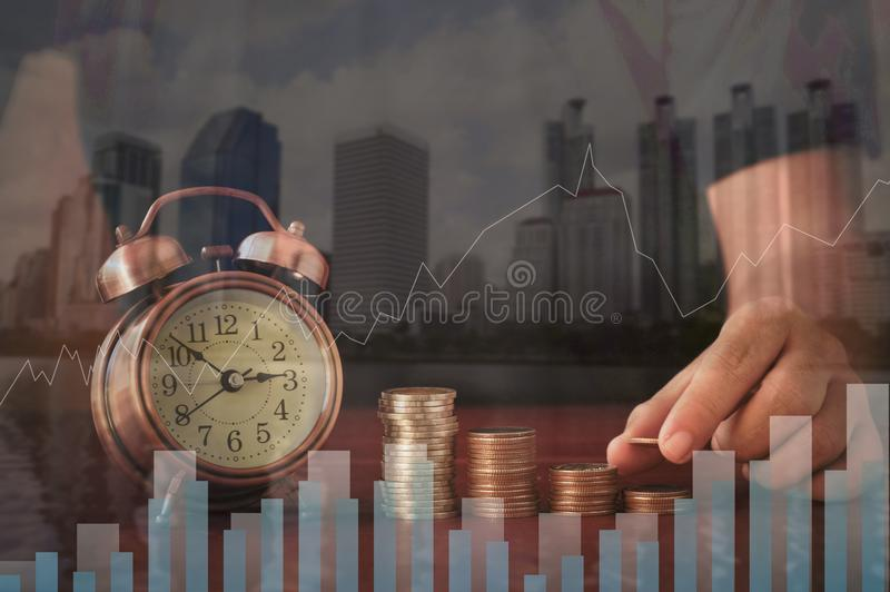 Double exposure put money pile of coins and night city, concept in growth, save and investment. In business stock photos