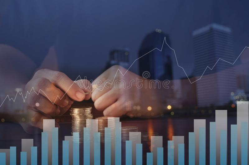 Double exposure put money pile of coins and night city, concept in growth, save and investment. In business stock images