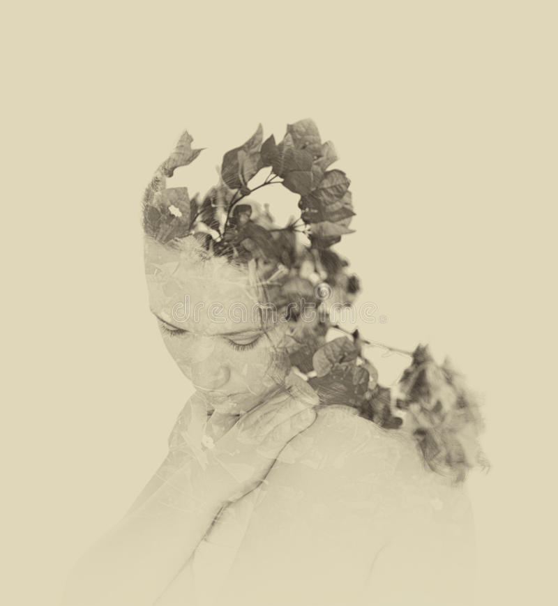 Double exposure of red flowers in the beautiful young woman. black and white image, vintage effect.  stock images