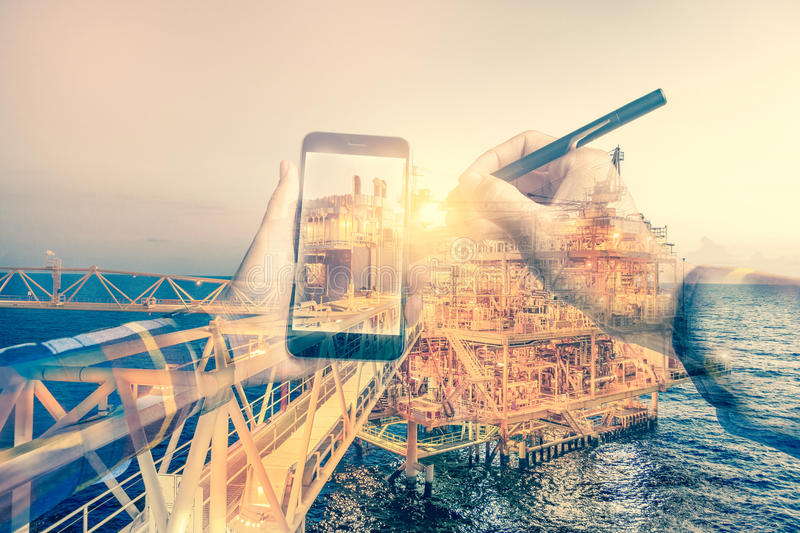Double exposure of refinery oil and gas background, and business royalty free stock image