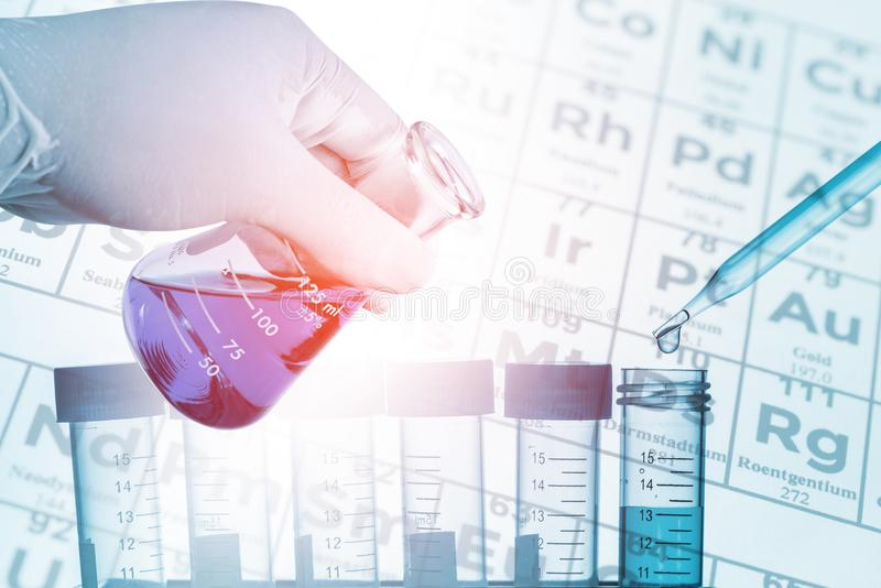 Double exposure of scientist hand holding laboratory flask with royalty free stock photo