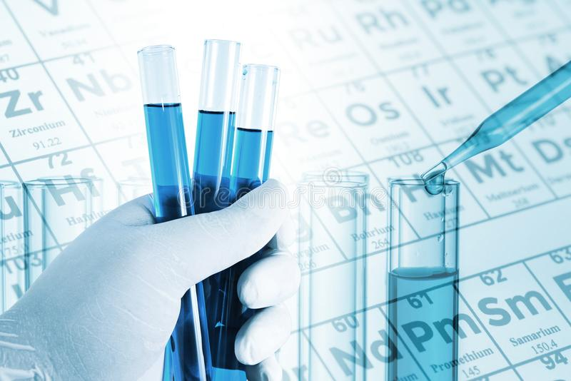 Double exposure of scientist hand holding laboratory test tube royalty free stock images