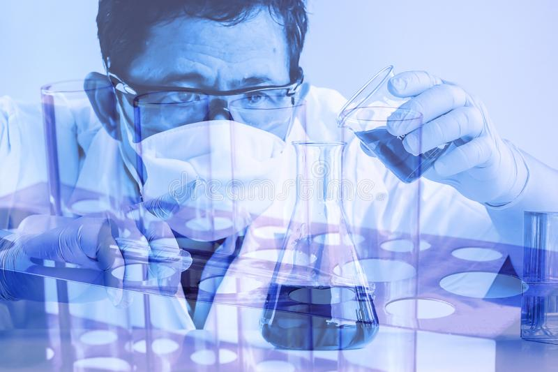 Double exposure scientist in laboratory to research with test tube , science concept stock images