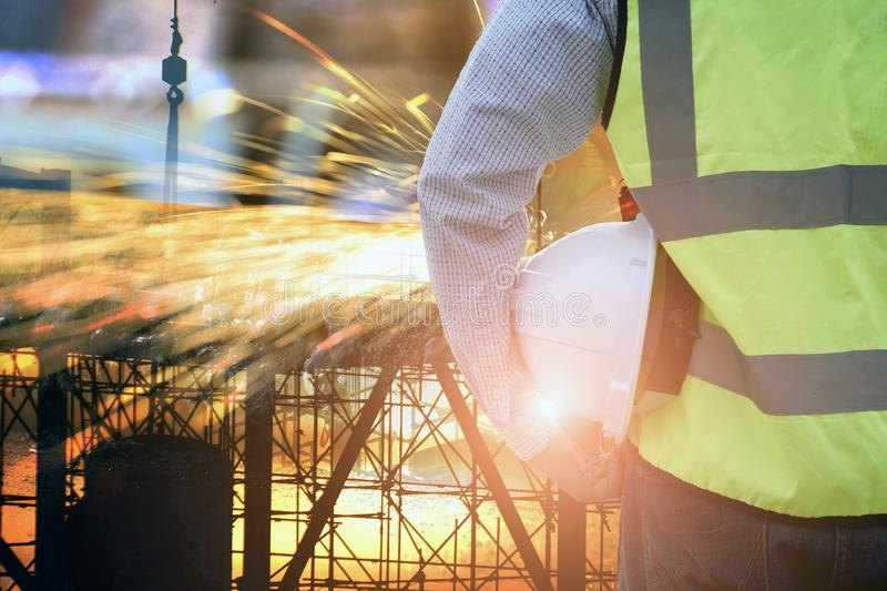Double exposure of silhouette construction site royalty free stock photos