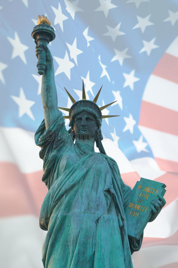 Double exposure of statue of liberty and American flag for independence day royalty free stock photo