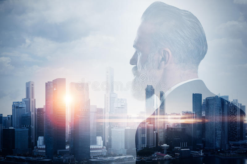 Double exposure of stylish businessman and stock photography