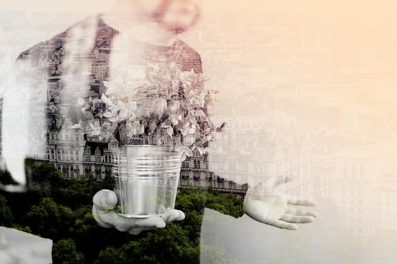 Double exposure of success businessman holding vase plant,tree,front view,filter effect. Double exposure of success businessman holding vase plant,tree,front royalty free stock images