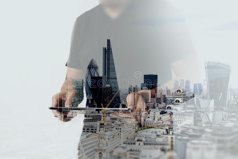 Double exposure of success businessman using digital tablet stock image