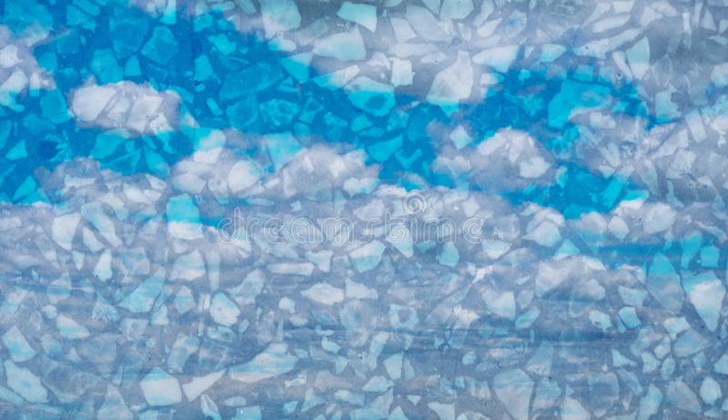 Double exposure of sweet pastel colored cloud with terrazzo stone texture, soft cloudy with gradient pastel color background. Double exposure of sweet pastel stock photography