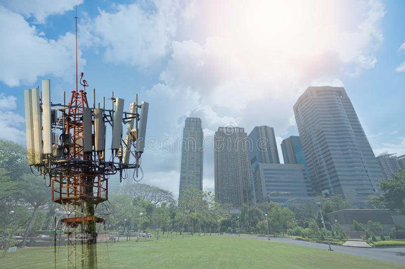 Double exposure of Telecommunication tower on city background. royalty free stock photography