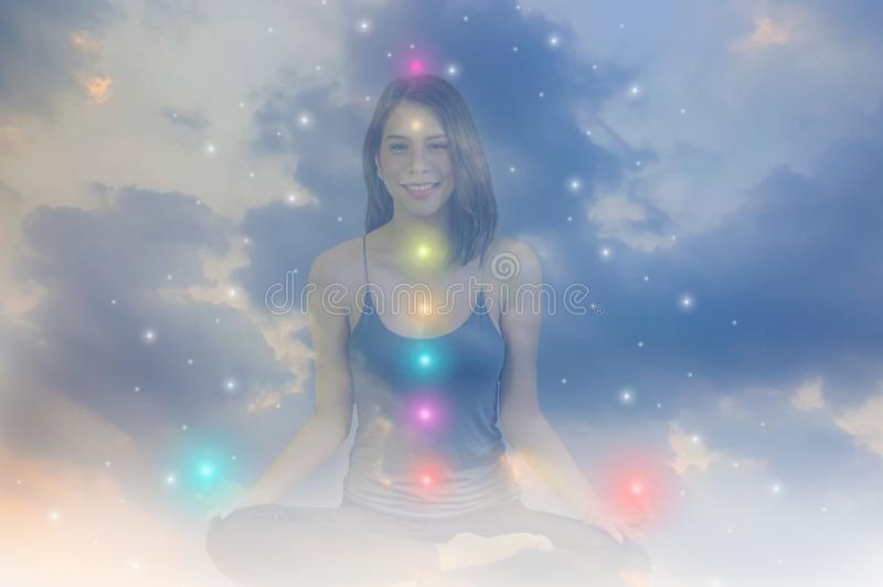 Double exposure-tranquility yoga woman meditation to purify mind,background sky,concept spirituality and suffering from royalty free stock photography
