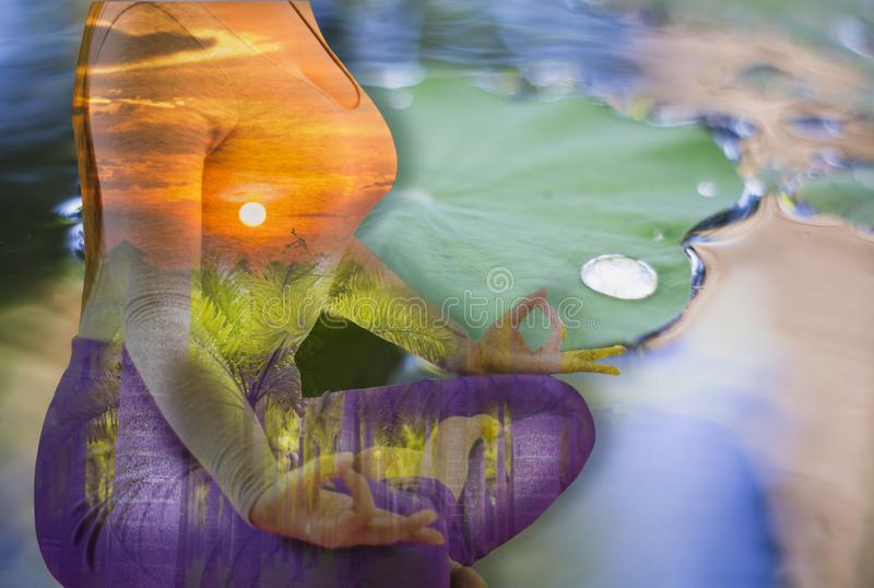 Double exposure - tranquility from yoga woman by meditation to purify mind,Lotus leaf background on the water,With concept of royalty free stock image