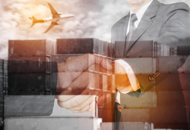 Double exposure two businessman hands shake. With container and air plane ,business logistick concept stock photos