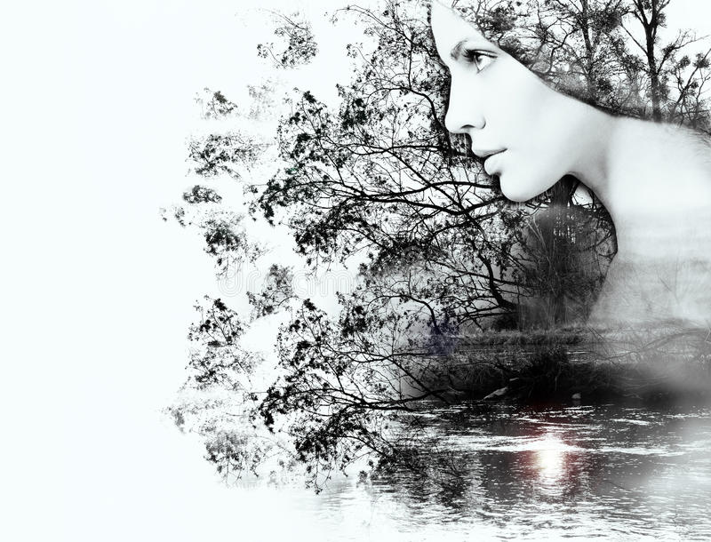 Double exposure of woman and beauty of nature at the sunset on t stock photography