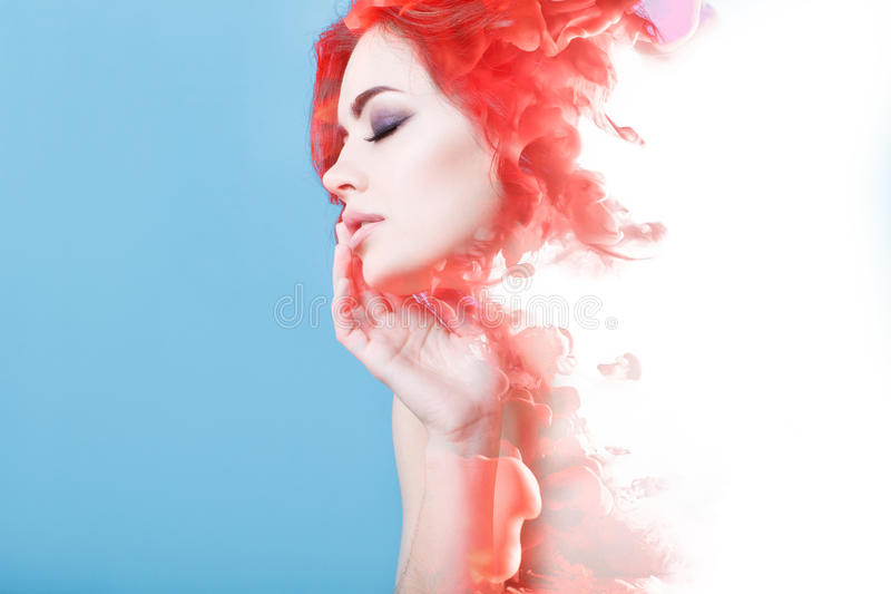 Double exposure woman and and a cloud of red smoke. royalty free stock photos