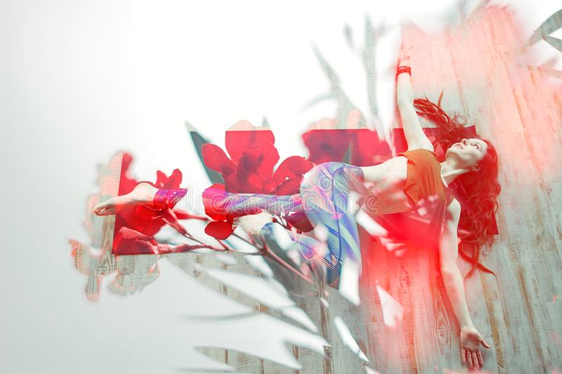 Double exposure woman practising yoga and toned oleander flowering branch on white background stock photo
