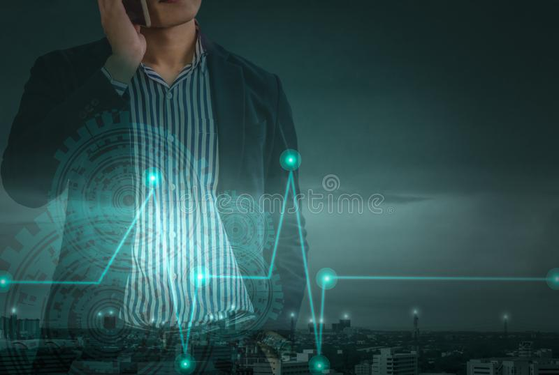 Double exposure - young asian businessman standing on phone, Concept of leadership in modern business world stock image