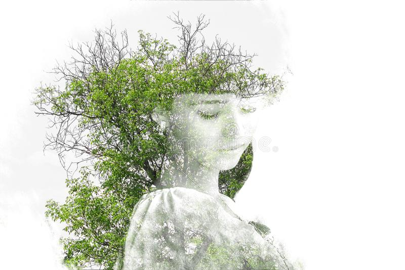 Double exposure of young beautiful girl among the leaves and trees. Portrait of attractive lady combined with photograph of tree stock illustration
