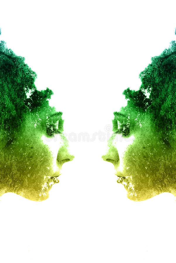 Double exposure of young beautiful girl among the leaves and trees. Portrait of attractive lady combined with photograph of tree. Creative. Effect of double stock photos