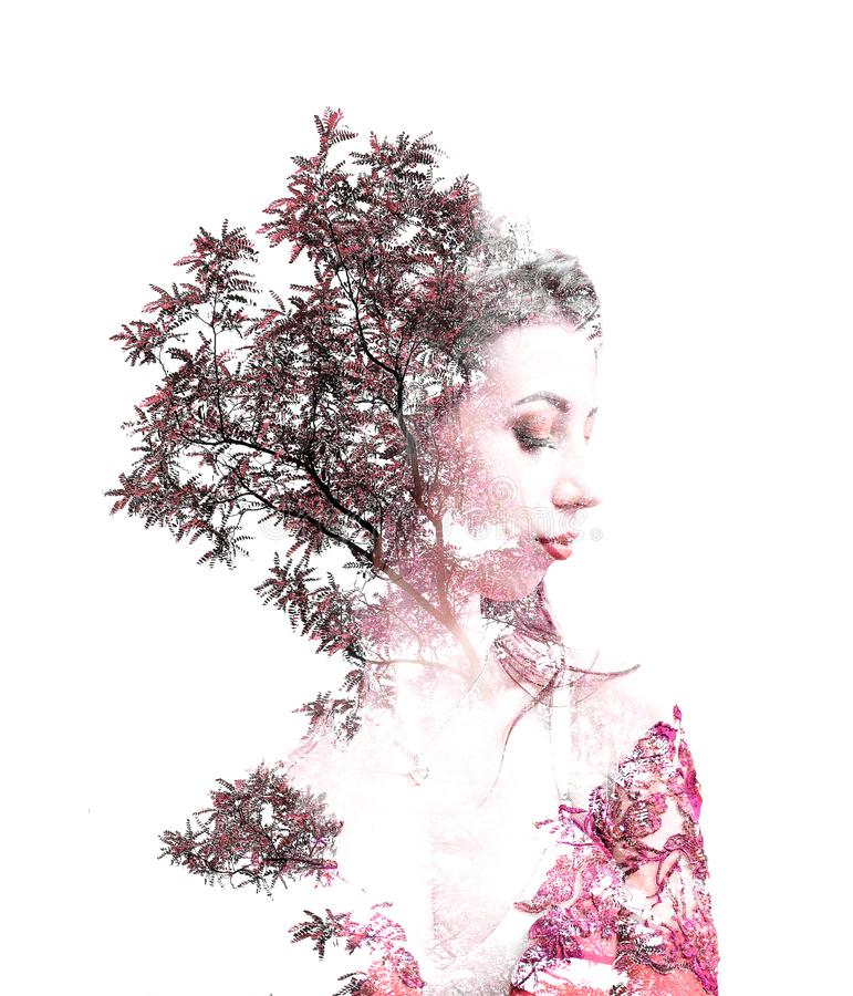 Double exposure of young beautiful girl among the leaves and trees. Portrait of a woman, mysterious look, creative, art, conceptua royalty free stock photos