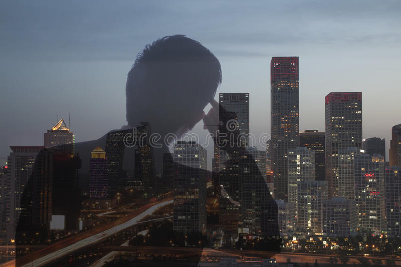 Double exposure of young businessman and the cityscape of Beijing, China royalty free stock photography
