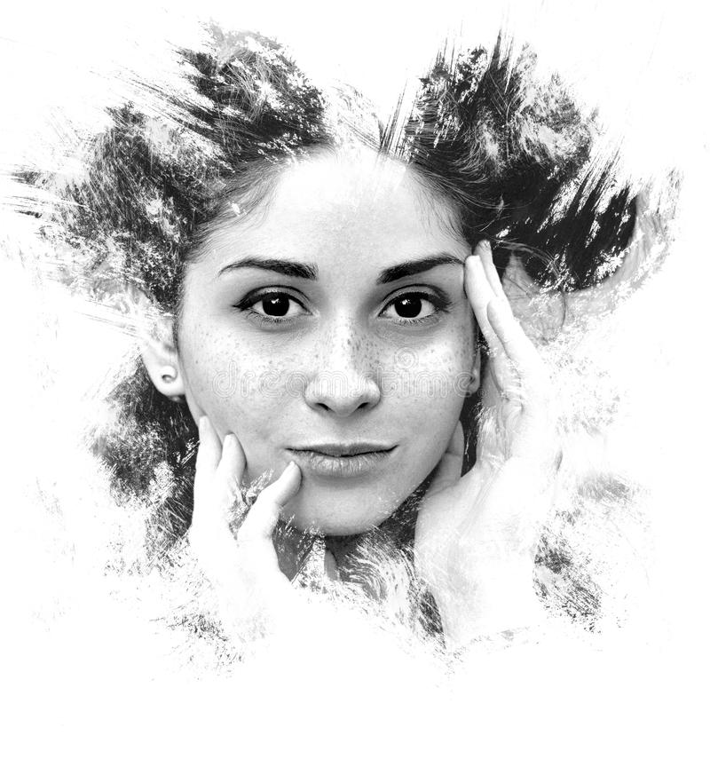 Double exposure of a young girl creative portrait. Art Dramatic stock photography