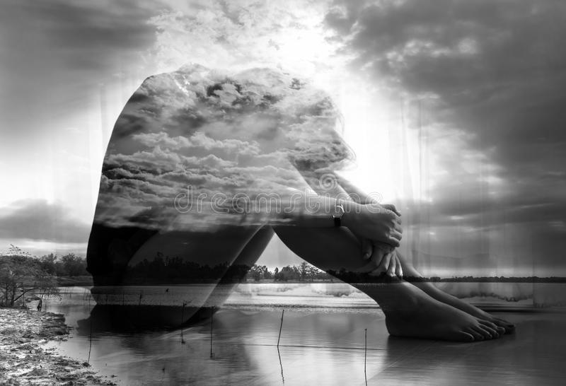Double exposure young woman sitting on floor royalty free stock photos