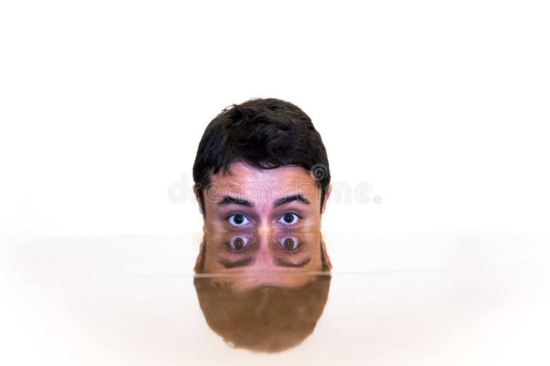 Double face. Reflected with white background royalty free stock image